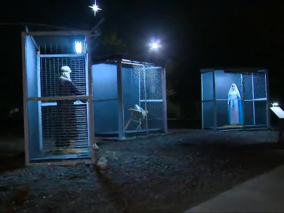 Nativity scene shows Jesus, Mary and Joseph in cages