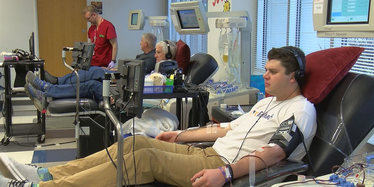 Family donating blood during the holiday season