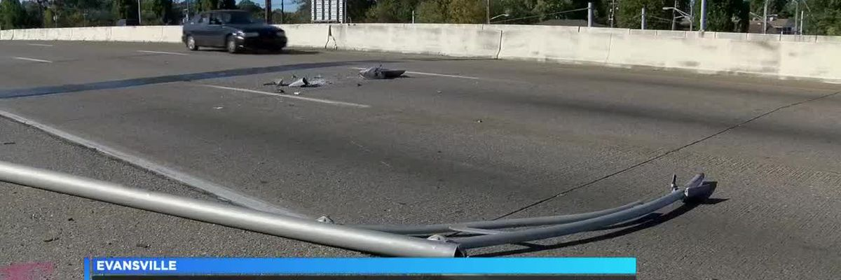 Wind knocks down light pole across Lloyd expressway