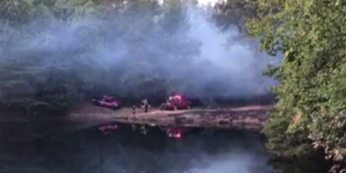 Brush fire in Evansville spreads into wooded area, threatened 3 homes
