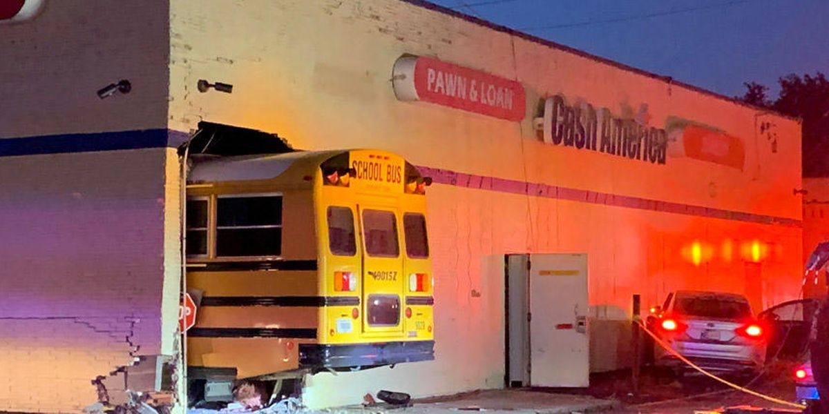 Indianapolis school bus carrying students crashes into shop