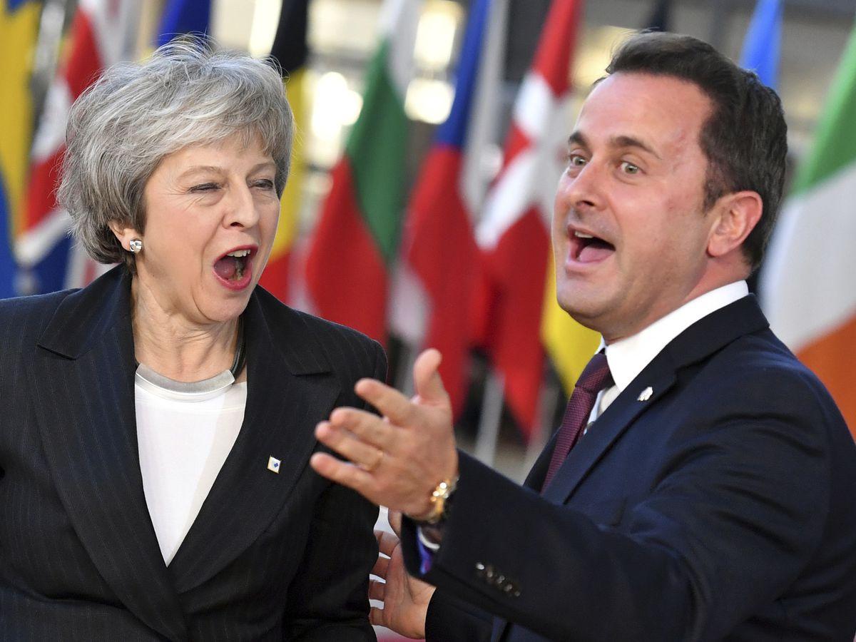 The Latest: Romania seeks to encourage British leader