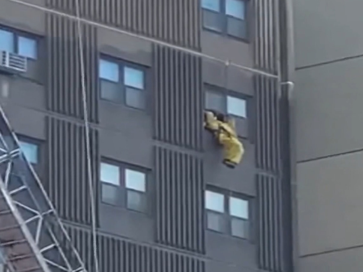 Window washers rescued from scaffolding collapse