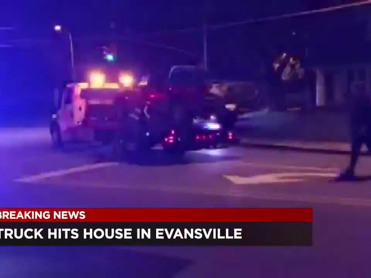 Truck goes through yards, hits home in Evansville