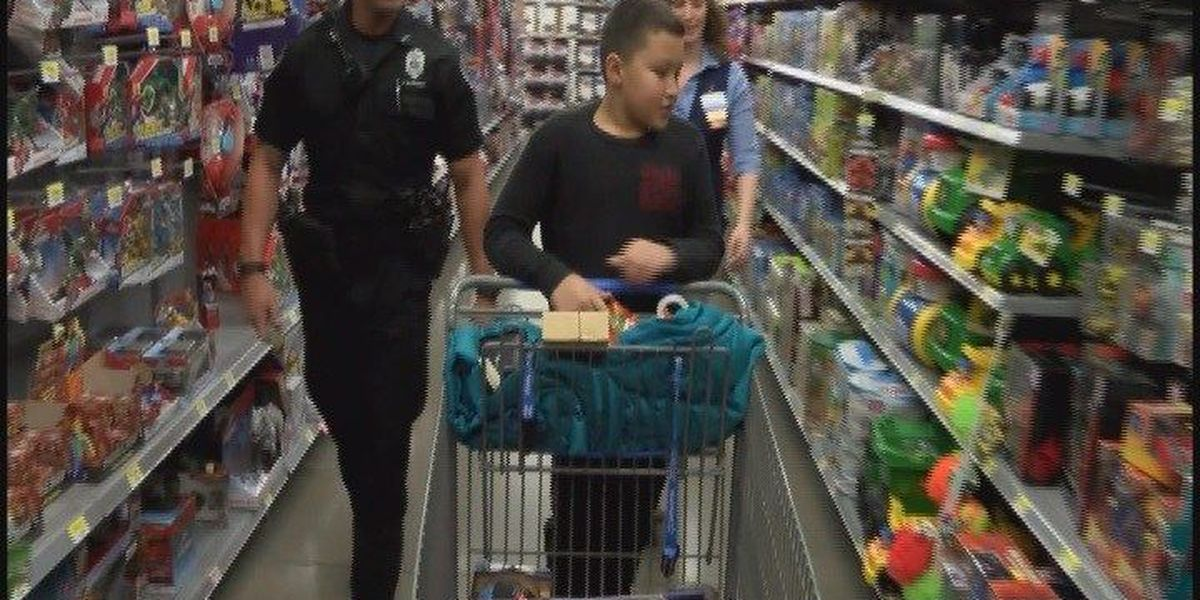 Police officers treat Newburgh students to holiday shopping spree