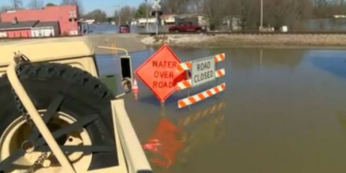 2 people arrested after being rescued from vehicle in high water