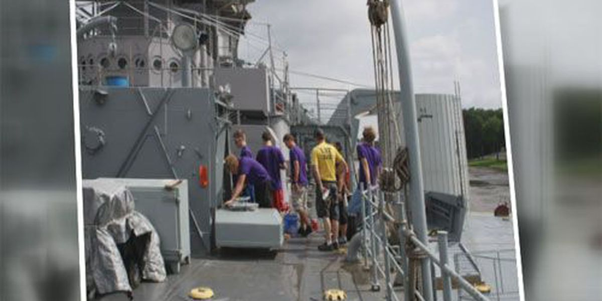 UE freshmen help with painting on LST 325
