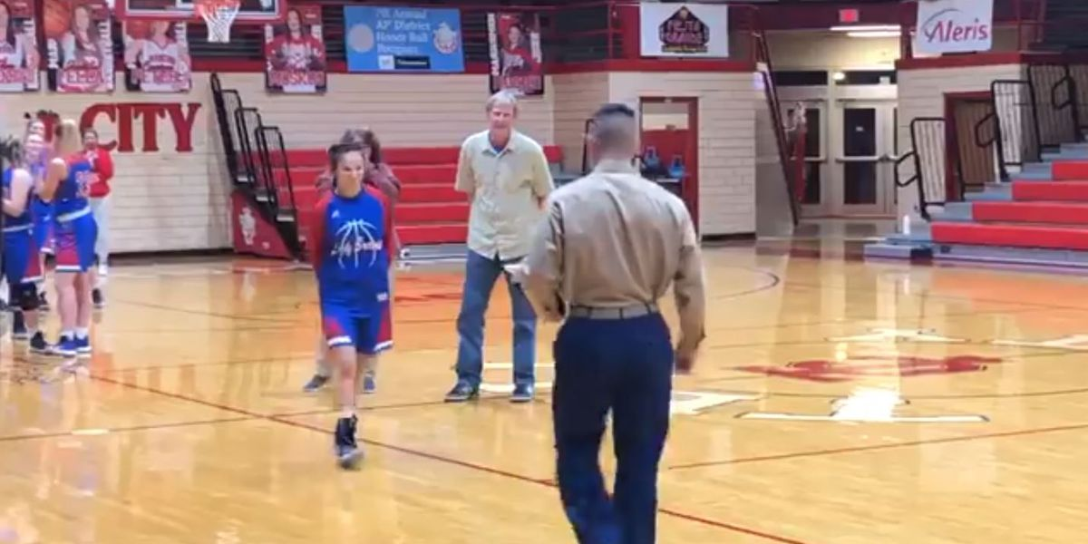 Marine surprises family at sister's basketball game