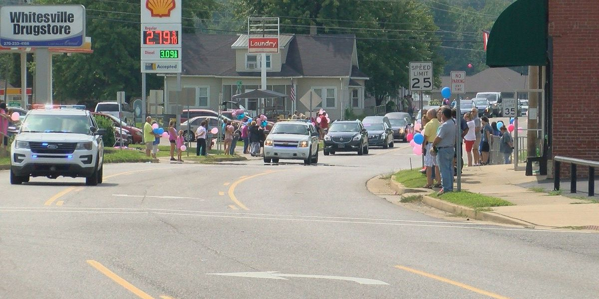 Community members gather for Henry funeral procession
