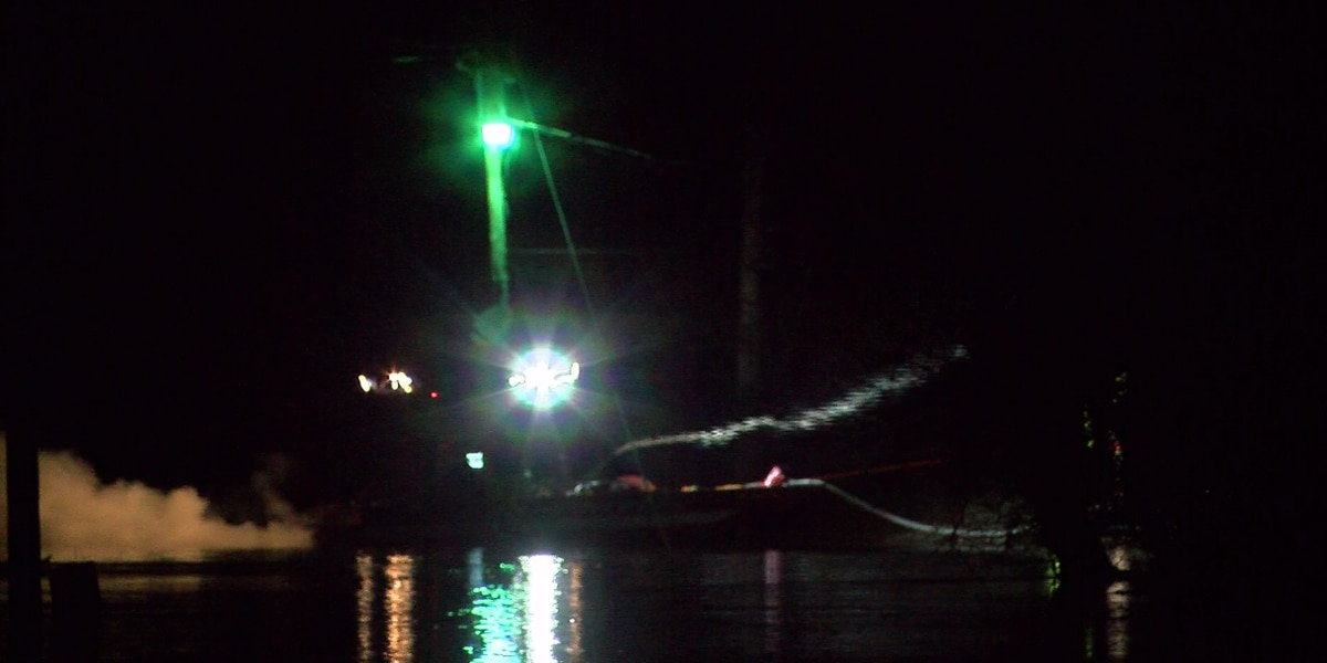 Fire crews use boat to get to New Harmony fire