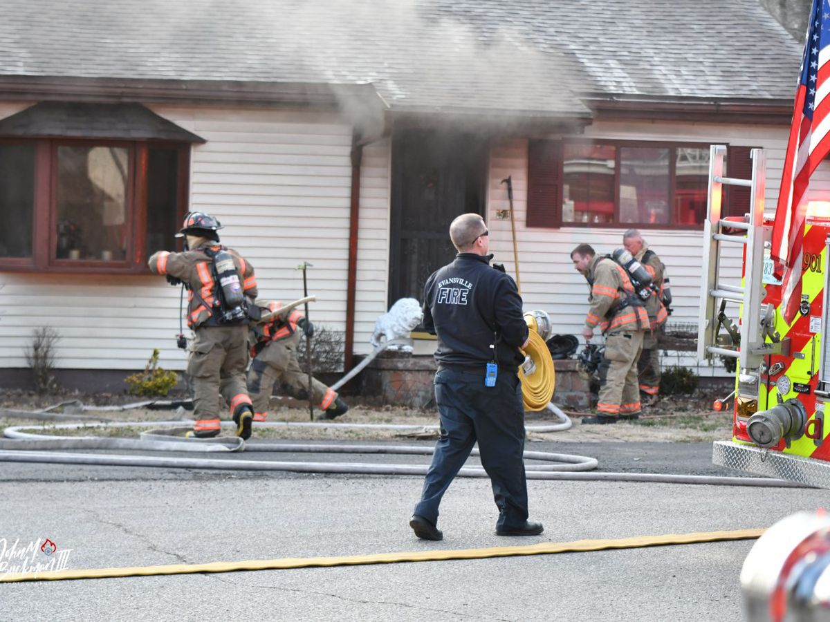 Woman hospitalized after Evansville house fire