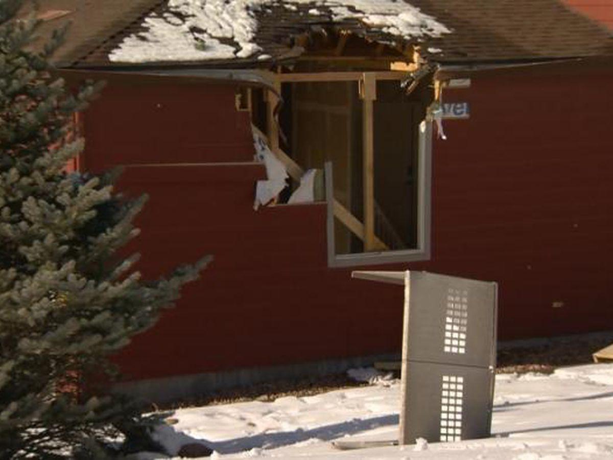 Airborne car crashes through 2 homes
