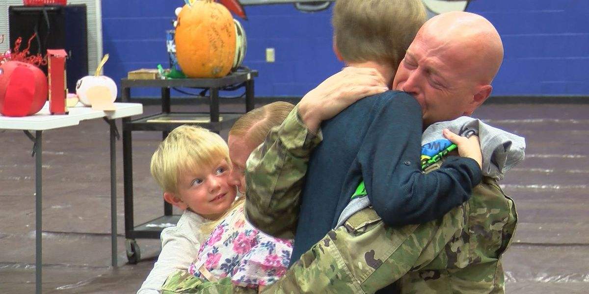 Soldier parents surprise kids at KY school after year deployment