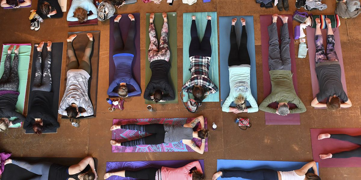 More US adults and kids are doing yoga, meditating