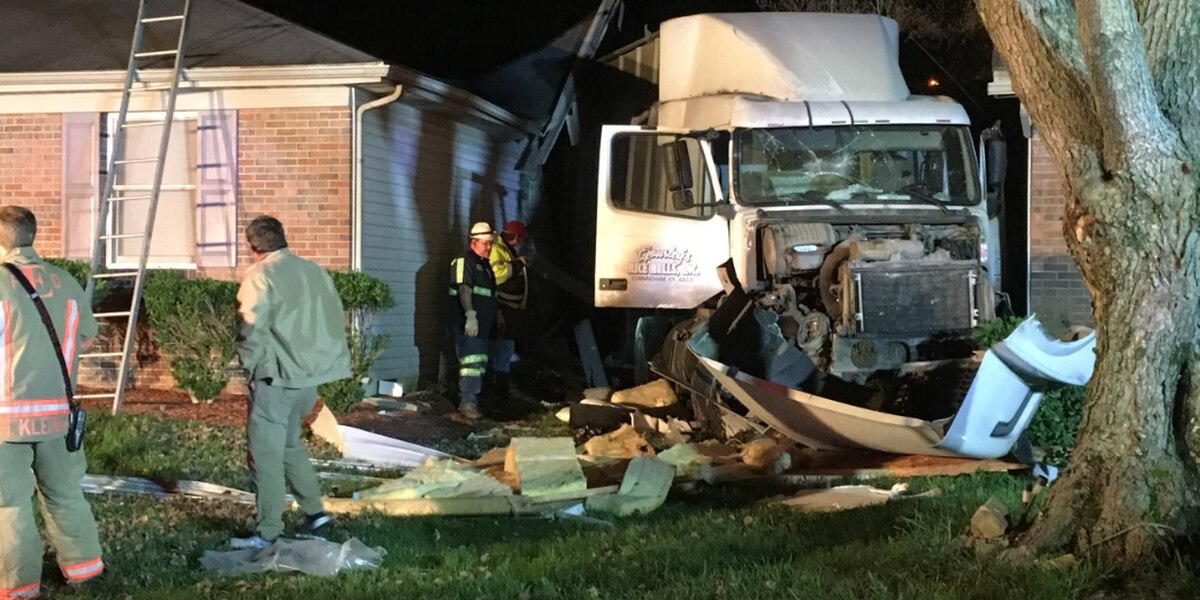 Semi crashes into home