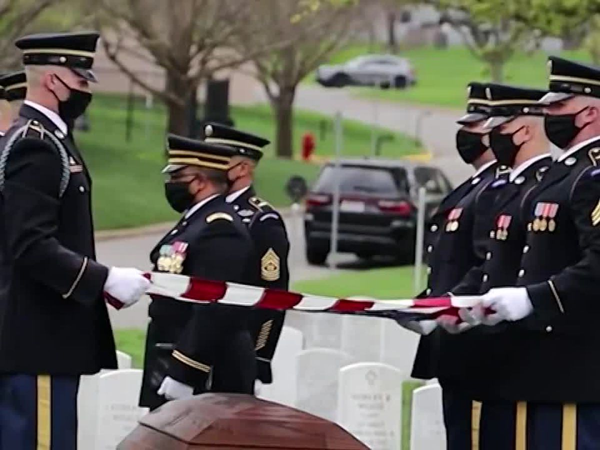 Solemn rituals carry on with new precautions at Arlington National Cemetery