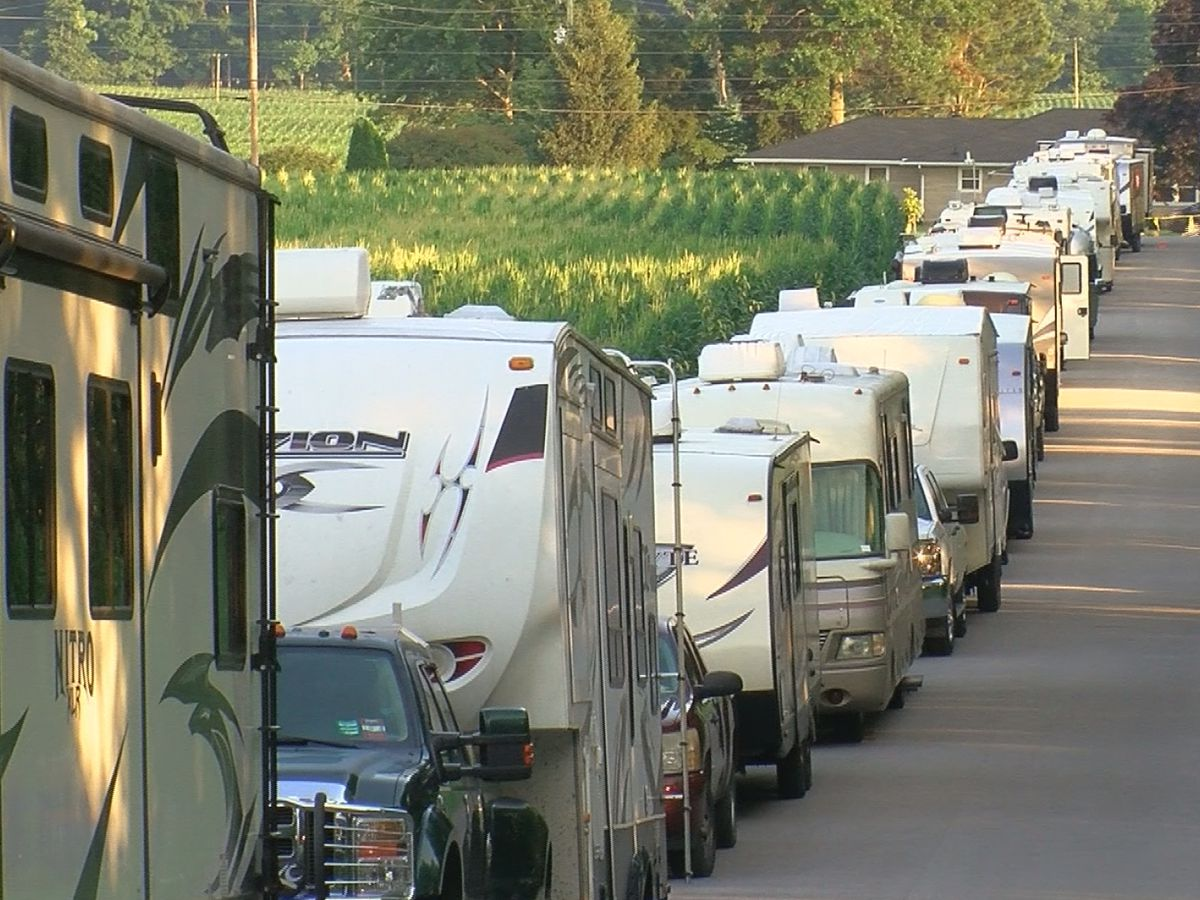 Campers wait in line with spot at 2019 ROMP Festival