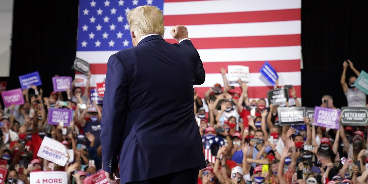 In defiance of Nevada governor, Trump holds indoor rally