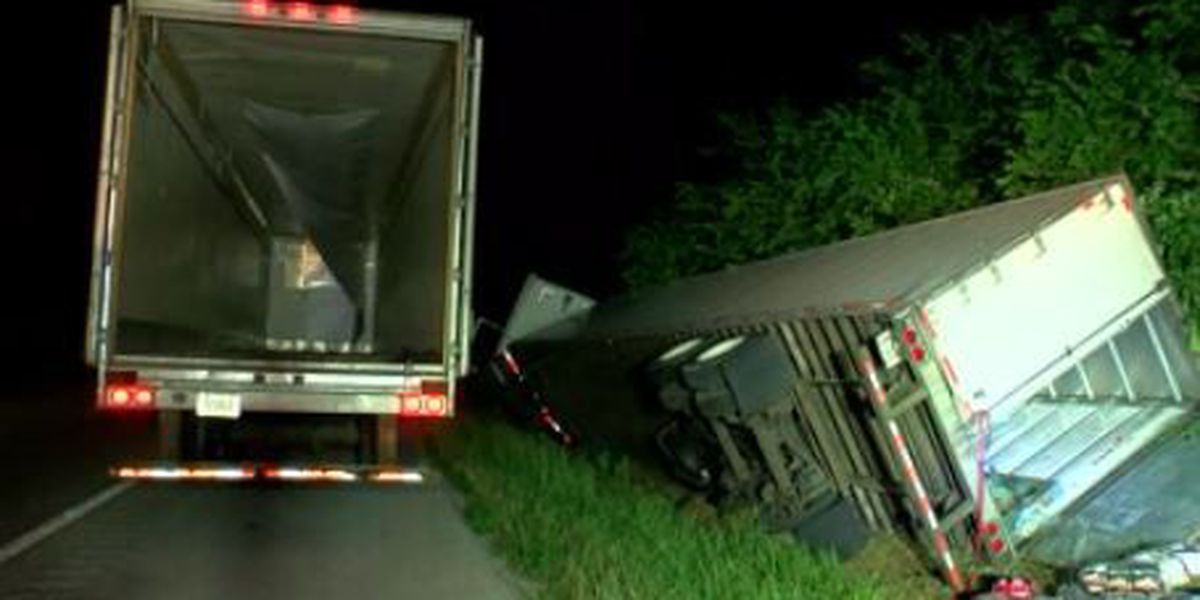 Semi hauling charcoal runs into ditch, causes traffic delays on Natcher Pkwy