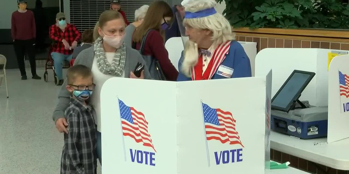 Poll volunteers say the Washington Square Mall location was the busiest Tuesday morning with roughly