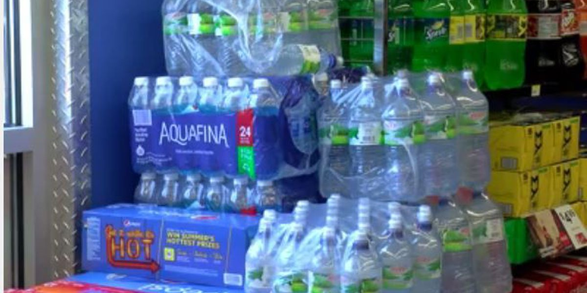 Gas station stocking extra gas, water, food in preparation for solar eclipse