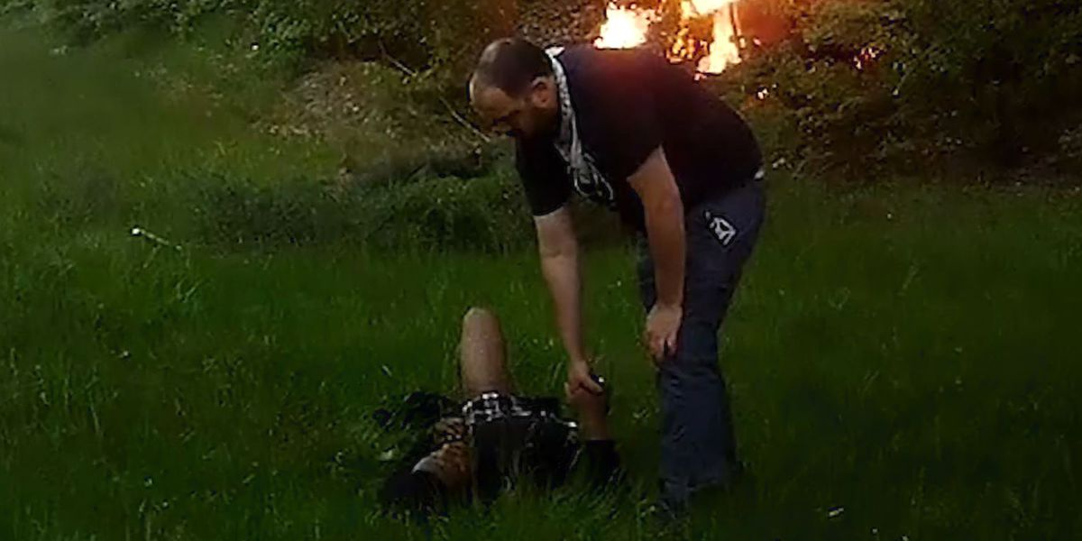 Good Samaritan rescues man from burning car, holds his hand while waiting for ambulance