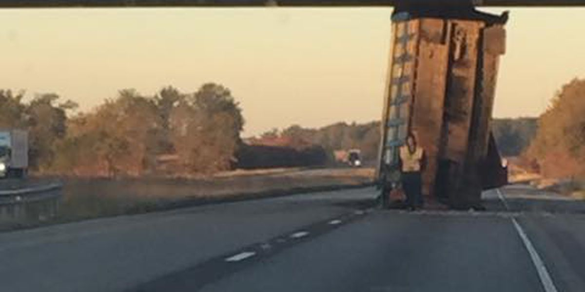 Dump truck gets wedged under IL overpass