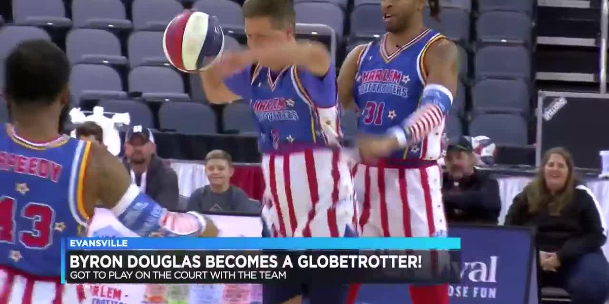 Byron Douglas plays with the Globetrotters