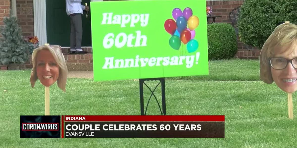 Family of Evansville couple place signs on pair's front yard to celebrate 60th anniversary