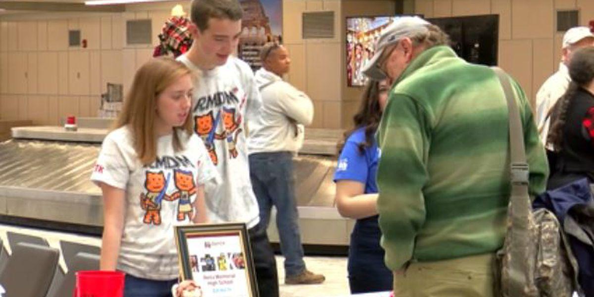 Memorial students promote dance marathon at Evansville airport