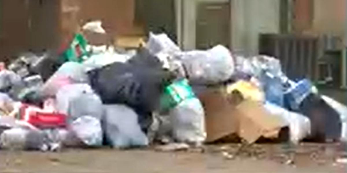 Dumpster arriving at Woodland Park Apartments after city flagged property for trash buildup