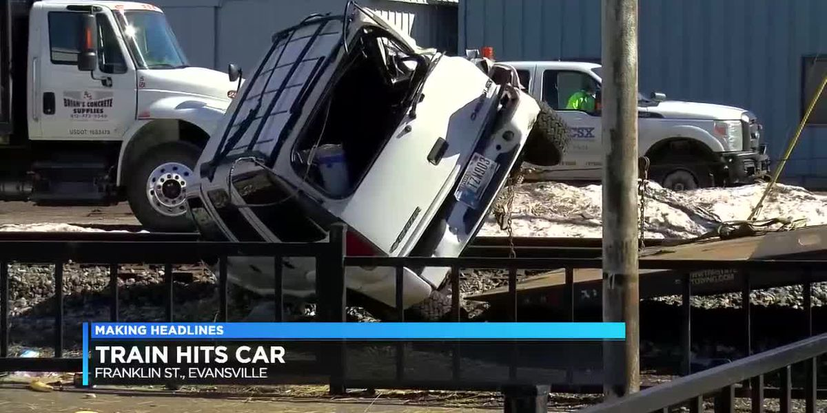 Driver escapes with minor injuries after car hit train