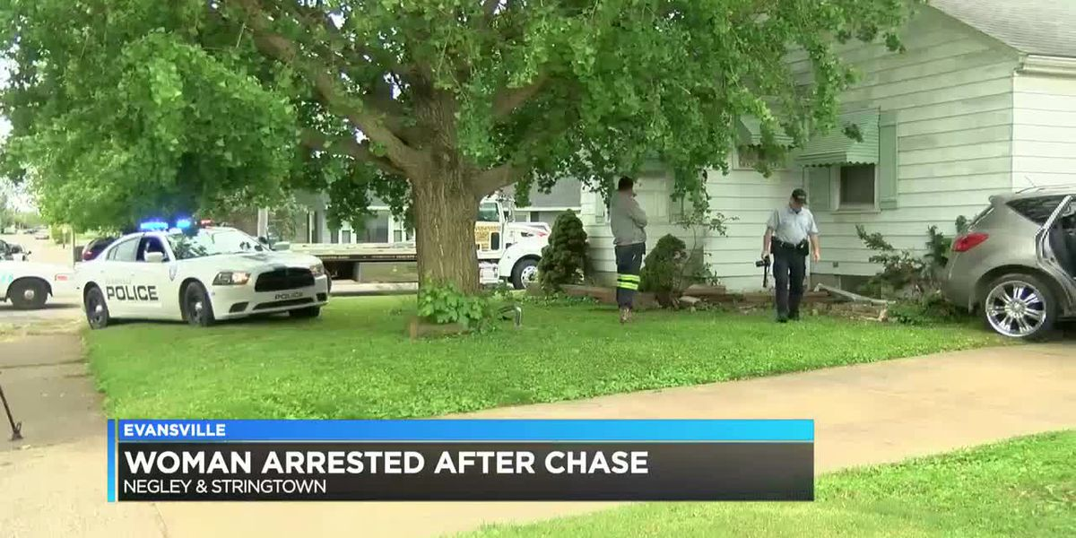 Police chase ends in crash into Evansville home, woman arrested