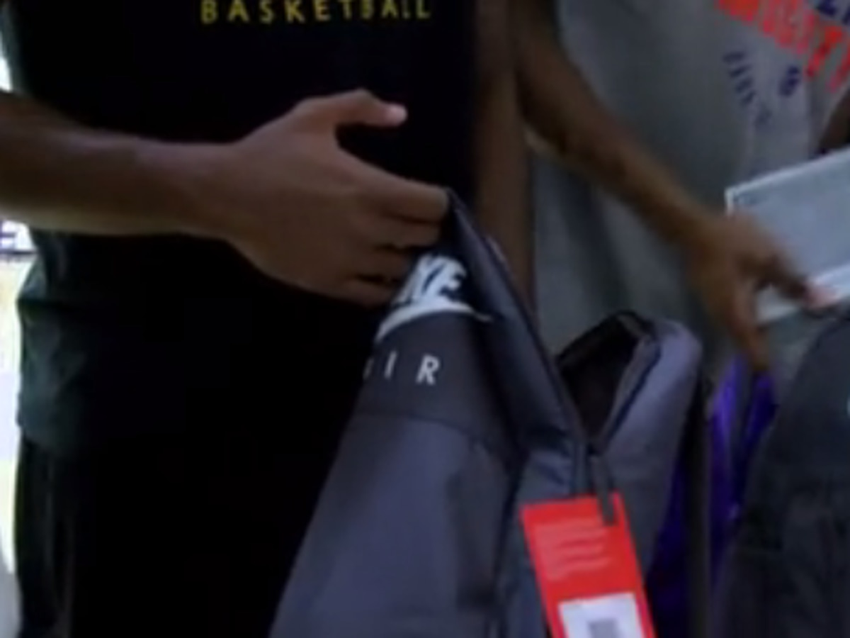UE men's basketball team gives school supplies to local students