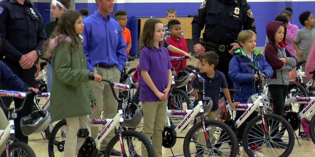 Evansville kids surprised with bikes and helmets