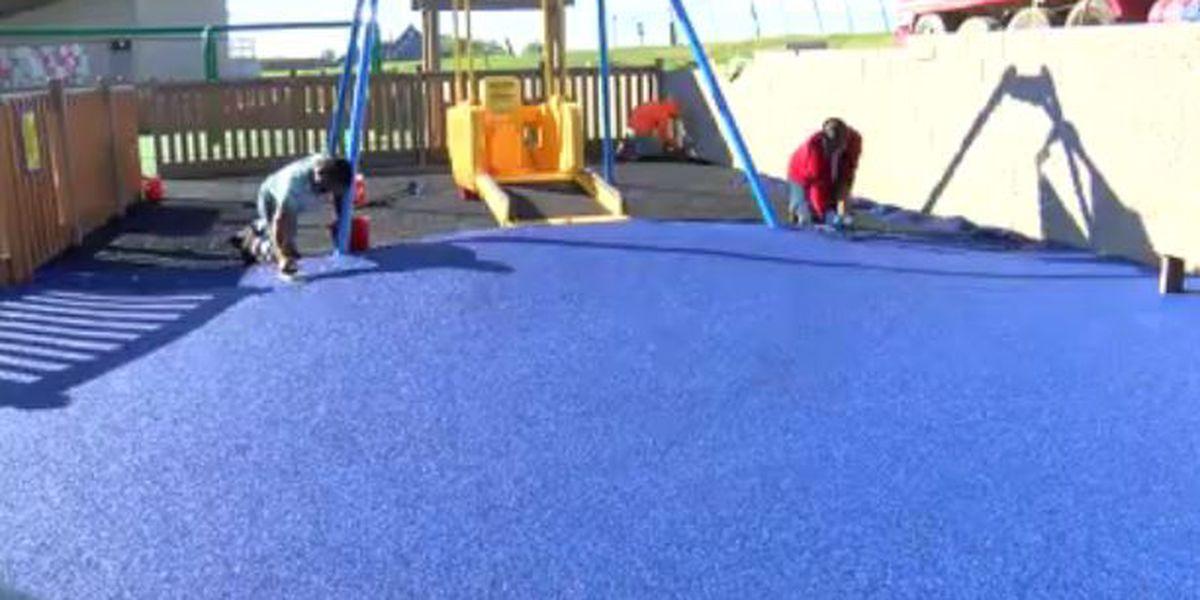 Crews work on playground surface of Mickey's Kingdom