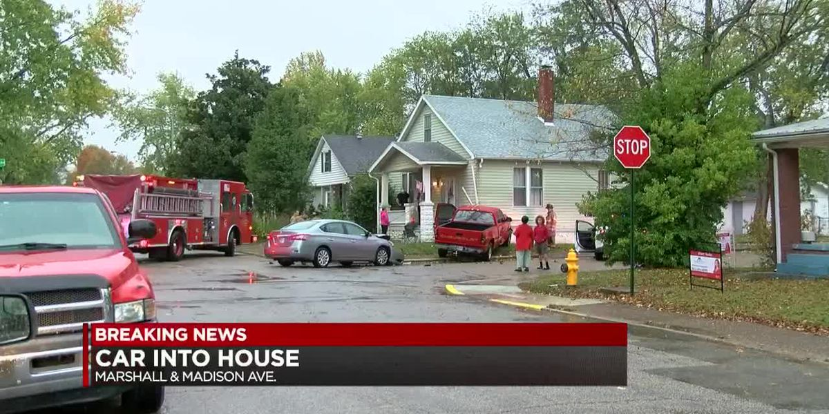 Truck crashes into house in Evansville