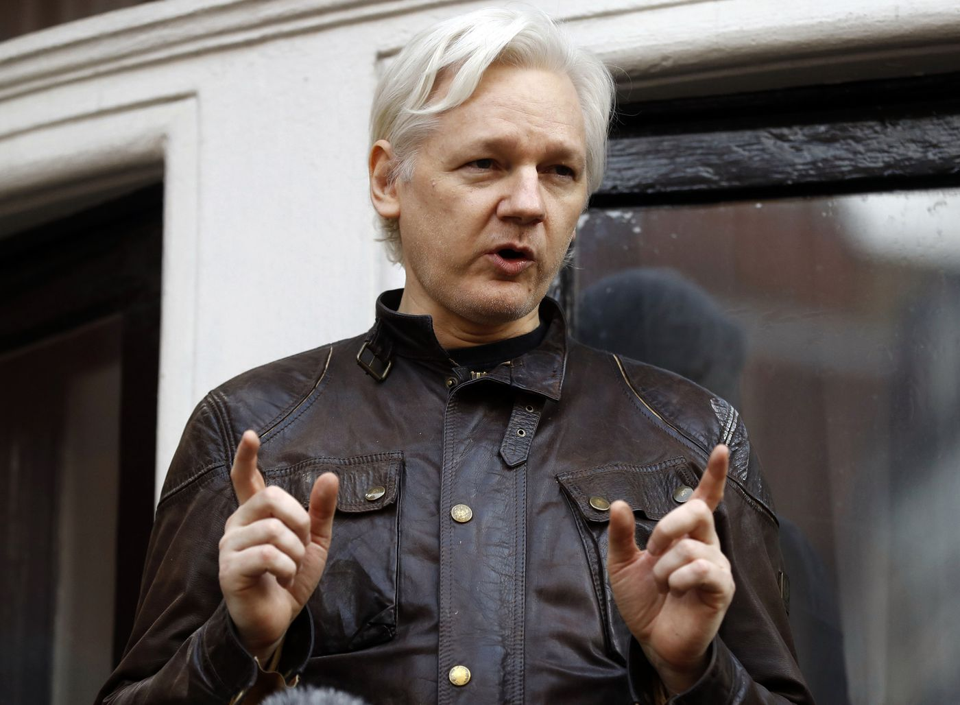 In this May 19, 2017, file photo, WikiLeaks founder Julian Assange gestures to supporters outside the Ecuadorian Embassy in London, where he has been in self imposed exile since 2012. He was arrested at the embassy Thursday.