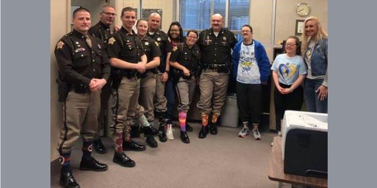 Daviess Co. deputies rocking socks on World Down Syndrome Day