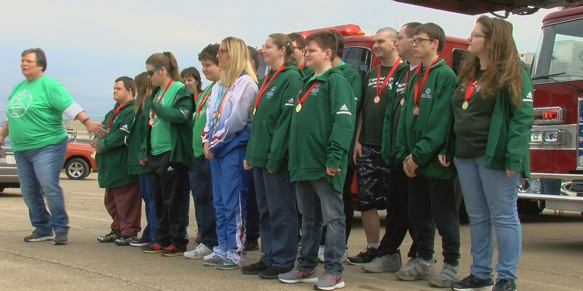 Special Olympics athletes welcomed home