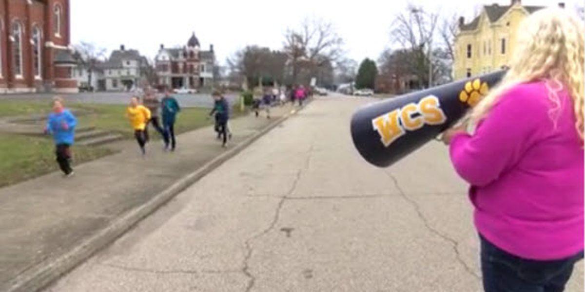 School hosts walk-a-thon to honor staff member