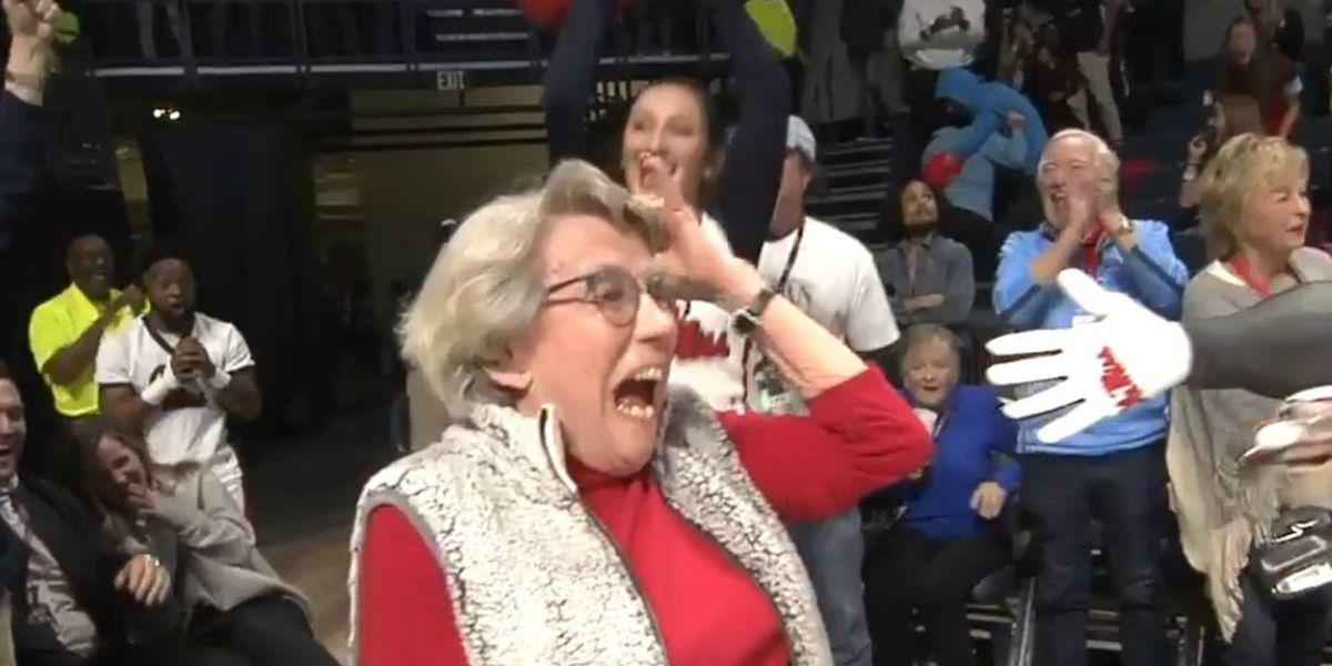 Woman, 84, sinks putt across basketball court to win new car
