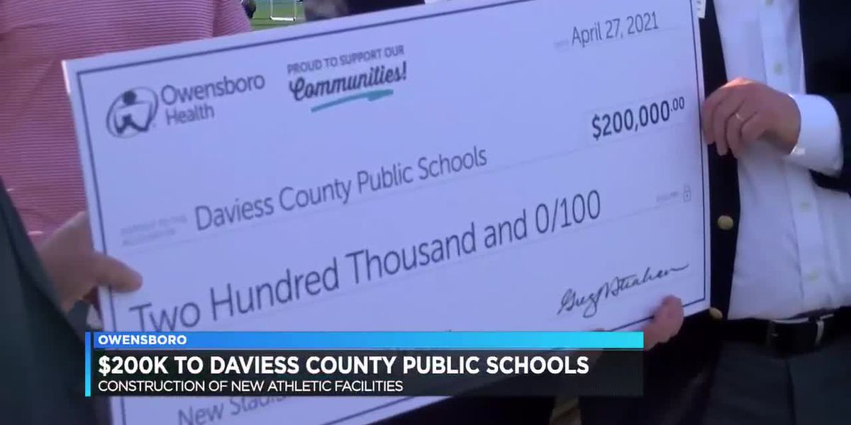 Owensboro Health presents $200K check to DCPS